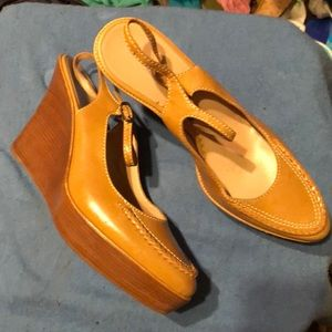 A tan ColeHaan sling back wedge shoe slightly used